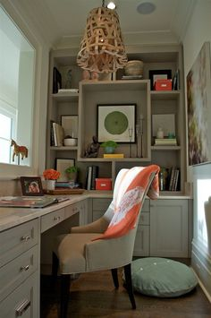 Love the idea of a little office nook like this as well as the little pops of coral here and there
