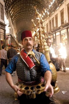 A man sells the traditional licorice drink Erk Sous in the Hamedia bazaar in downtown Damascus
