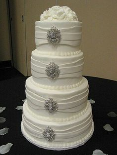 White wedding cake with bling,  crystal brooches