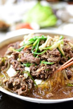 Authentic bulgogi is easy to make at home with a few basic ingredients. Here's everything you need to know about how to make the best bulgogi! This recipe also shows how to enjoy it Seoul style. Korean Bbq Beef, Korean Food, Korean Bulgogi, Korean Dishes, Asian Recipes, Beef Recipes, Ethnic Recipes, Raw Recipes, Marinated Beef