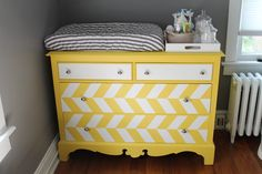 This #DIY #yellow dresser/changing table adds so much character to this lovely #gray #nursery .
