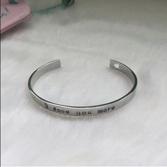 """""""I love you more"""" silver bangle Brand new. Silver tone with the words """"I love you more"""" and heart cutout. Bundle to get even bigger savings! Offers welcome. ❌No trades Boutique Jewelry Bracelets"""