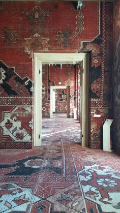 Incredible English Manor, with Walls upholstered with Vintage Persian Tribal Rugs. Masculine and Modern.