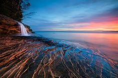 Get Your Beach Fix with These 15 Free Ocean Wallpapers: Waterfall Beach at Wallup