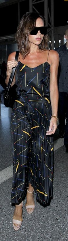 Who made Victoria Beckham's black sunglasses, pleated print skirt, spaghetti tank top, and handbag?