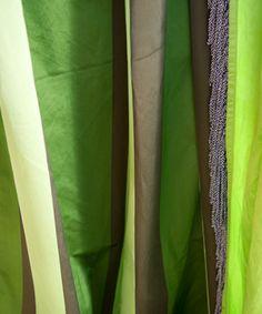 The luxurious Dukala in emerald silk stripes