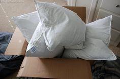 Our brand new, white, fluffy 'down' Hampton Inn pillows!