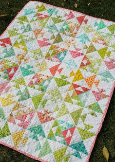 """Kissing Fish Baby Quilt (Freshly Pieced) free download on CRAFTSY /  This baby quilt gets its name from the way the blocks look a little like kissing fish. It makes a great scrap quilt! With careful cutting, a 6"""" print square (plus solid white) will get one """"kissing fish."""" The Pattern By Freshly Pieced"""