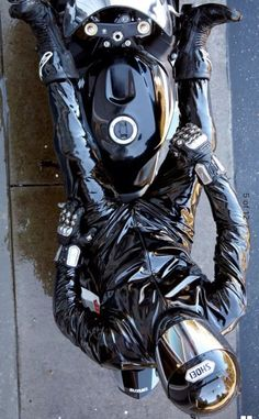 """whipman-andy: """" Biker rain suit….can also be worn in the bright sunshine, if you like your leathers steaming hot :-) """""""