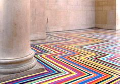 Since 1999, Glasgow-based artist Jim Lambie has used ordinary vinyl tape to transform spaces into visual wonders in his signature floor series Zobop.