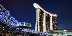 Marina Bay Sands. Luxury accommodation, shopping, dining and entertainment. The biggest hotel in Singapore! It is 55 storeys and has views of the South China Sea and Singapore Skyline and more! Check out this link!