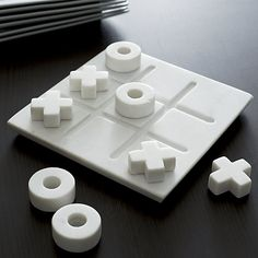 Marble play set elevates the common game of tic-tac-toe to chess-set status in gorgeous white marble. Solid white pieces move on a clean square, carved with a grid. A beautiful accent at play or on display. Crate And Barrel, Barrel Table, Coffee Table Games, Decorating Coffee Tables, Coffee Table Tic Tac Toe, Diy Clay, Clay Crafts, Family Yard Games, Architecture 3d