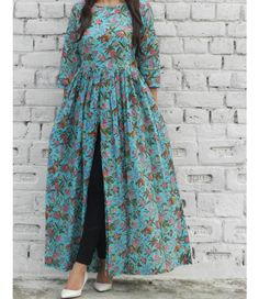 Shop online Aqua burst cape Aqua green block printed malmal cape with boat neckline and lining in the bodice Pakistani Dresses, Indian Dresses, Indian Outfits, Indian Designer Outfits, Designer Dresses, Hijab Fashion, Fashion Dresses, Maxi Dresses, Maxi Skirts