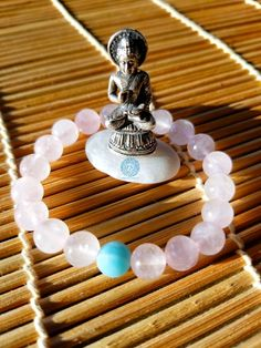 It's all love with this soft rose quartz with amazonite keystone mala style bracelet. Rose quartz and amazonite are a direct connect to the heart. Best worn on the left arm, these open the voice and throat chakra - with amazonite supporting emotional and physical healing. Meditate with these or adorn yourself for an extra little shine.
