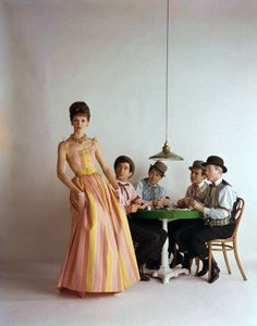 Late 1950s, New York    Singers Bobby Darin and Eddie Fisher sit with actors Red Buttons and Ben Gazzara pose playing cards while dressed as 19th century gamblers as fashion model Lucinda Hollingsworth ambles by. Fashion editorial for McCall's Magazine.    Image by © William Helburn/Corbis