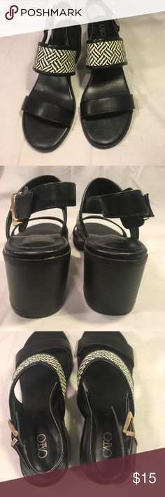 """{Cato} sandals Black & white {Cato} sandals. Sandals have one solid black strap and a black and white basket weave strap with buckle around ankle & 2 1/4"""" chunky heal. Uppers are in great condition, with some scuffing on bottom of heals. Cato Shoes Sandals"""