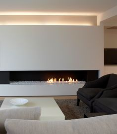 sleek fireplace, with additional design elements, so the fire doesn't need to be on. Estilo Interior, Modern Interior, Interior Architecture, Interior Design, Home Fireplace, Fireplace Design, Fireplace Lighting, Linear Fireplace, Design Moderne