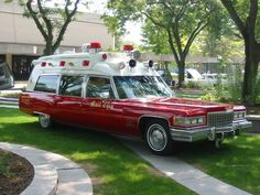 vintage red Cadillac ambulance white roof