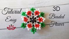 Seed beads beaded flower - tutorial List of materials: seed beads of 4 colours (red, black, white and red) (or bigger bead) - for the center of the . Beaded Flowers Patterns, Beaded Jewelry Patterns, Beading Patterns, Art Patterns, Bracelet Patterns, Seed Bead Tutorials, Beading Tutorials, Beading Projects, Seed Bead Flowers