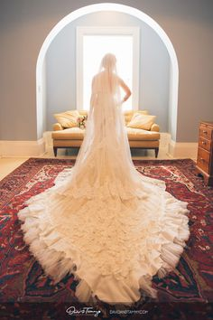 I'm not sure who this dress is by, but I cannot get over that train!! LOVE this dress!! (Photograph by David & Tammy Molnar)