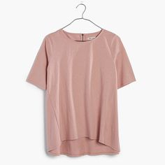 A swingy back-zip tee in textural slub cotton. Garment-dyed for a cool dimensional color, this easy top has an elliptical hem (translation: it's a bit longer in back).  <ul><li>Drapey fit.</li><li>Cotton.</li><li>Machine wash.</li><li>Import.</li></ul>