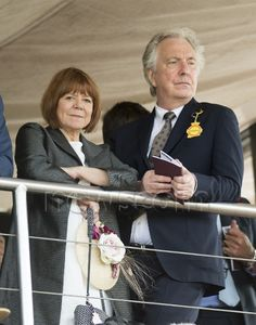 Alan Rickman and Rima Horton, his longtime girlfriend and and recently his wife, Qatar Goodwood Festival - Racecourse on July 29, 2015 in Chichester, England.