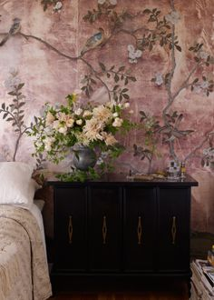The floral design within this De Gournay chinoiserie wallpaper, perfectly reflects the hydrangea detail of the Hélène bed frame. The soft pink compliments the gold tones in other areas of the scheme.