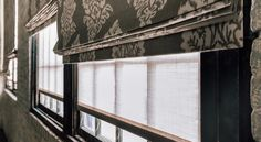 Roller Shades look rich layered under Roman Shades. Rollers shown in material Chelsea, color Sand.   The Shade Store