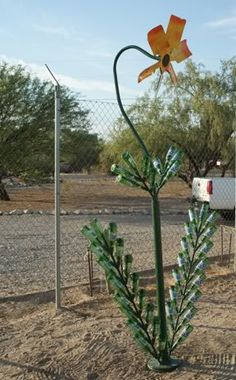 Javelina proof low water flower made from pipe, rebar, Caterpillar engine fan, and 44 bottles of Rolling Rock. - See more at: http://s1201.photobucket.com/user/Tin_foil_hat/media/BigFlower.jpg.html#sthash.aTONbiJJ.dpuf