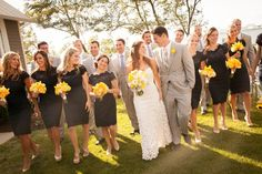 Black bridesmaid dresses with yellow bouquets and light gray groomsmen attire // Photographer: Artful Weddings