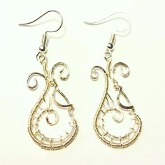 Fancy wire weaved earrings in a teardrop shape, 3 different gauge wires were used. and Inner S shape is hammered for strength. The drop length is Width is . All silverplate non tarnish wire. Wire Weaving, Silver Plate, Jewelry Making, Fancy, Drop Earrings, Jewels, Weave, Handmade, Strength
