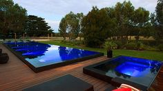 Raised black tile pool and spa with infinity edge on all sides. Very sleek. Pinned to Pool Design by Darin Bradbury.