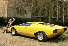 1971 Lamborghini Countach LP500 (stands for Longitudinale Posteriore, 5 liter). Styled by Marcello Gandini (Bertone). Engineered by Paolo Stanzani. Premiered at the 1971 Geneva Auto Show. 5000cc/305.12cu.in. 60° V12 DOHC, 2 valves/cyl., 6 twin-throat Weber 45 DCOE carburetors. The car was modified several times to aid in testing and was completely destroyed in a crash.
