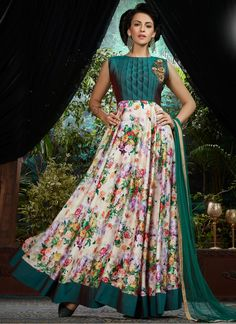 Add a adolescent burst of colour for any wardrobe with this teal and white satin designer gown. The ethnic embroidered and print work over a clothing adds a sign of splendor statement for the look