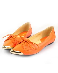 tangerine Chanel lace-ups oxfords with metal tips. LOVE