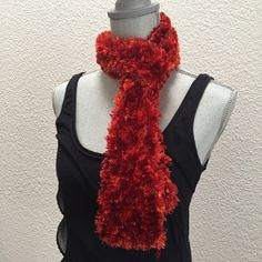 Firey handmade scarf Firey handmade scarf in the most gorgeous color. 59 inches log. 3inches wide when not stretched. Can be pulled wider.  EUC. Handmade Accessories Scarves & Wraps