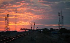 Sunrise at the Soyuz Launch Pad. The sun rises as the Soyuz TMA-14M spacecraft is rolled out by train to the launch pad at the Baikonur Cosmodrome, Kazakhstan, Sept. 23, 2014. It carried Expedition 41 Soyuz Commander Alexander Samokutyaev and Flight Engineer Elena Serova of Roscosmos, and Flight Engineer Barry Wilmore of NASA to the International Space Station. Image Credit: NASA/Joel Kowsky