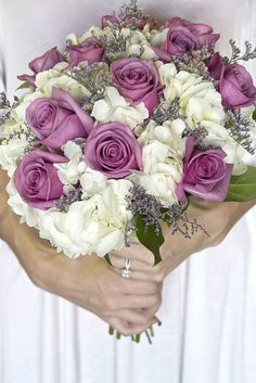 Wedding Bouquet of white hydrangeas, lavender roses, accented with purple caspia, surrounded with greenery.