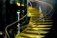 This large helical staircase has triangular stringers, cables and colour.