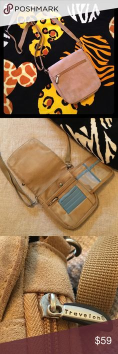 """Travelon Suede Crossbody Bag Versatile bag that is small enough to carry comfortably yet has space for all your needs. Front flap hides wallet and back has covered belt loop to carry at waist. Bag is 7""""x8"""" in size with adjustable strap. Travelon Bags Crossbody Bags"""