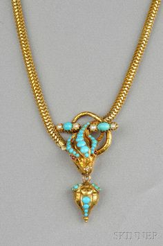 FINE JEWELRY - SALE 2601B - LOT 309 - GOLD AND TURQUOISE SNAKE NECKLACE, THE HEAD SET WITH CABOCHON TURQUOISE, SUSPENDING A CONFORMING DROP AND COMPLETED BY SNAKE LINK CHAIN - Skinner Inc
