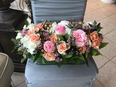 Gorgeous peaches, pink and white flowers in a rectangle vase. Contact Marion at Bayview florist wedding studio in Sayville, NY. Maz851@aol.com