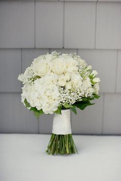 bouquet with baby's breath, roses and hydrangea-want this as either a bridesmaid or bridal bouquet!
