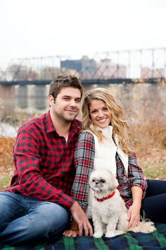 Plaid Engagement Photo but put chalkboard with wedding date where dog is then carry chalkboard idea through wedding
