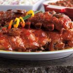 Have plenty of napkins on hand to catch the drips from these lip-smackin' slow cooker rib delights.    Used 6-quart slow cooker