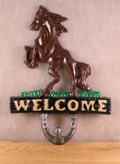 A personal favorite from my Etsy shop https://www.etsy.com/listing/461644616/horse-welcome-hook-cast-iron