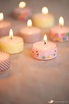 I love this super simple decor idea from Lebenslustiger... Washi Tape Tea Lights.Yes, it is as easy as it sounds... just pop a strip of Washi Tape around some Tea Lights! It's a very quick and che...
