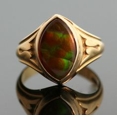 The Fire Agate in this ring is amazing in color! It is set in an elegant gold mounting with a simple linear detail on the band. This unique ring would make a lovely addition to anyone's jewelry wardrobe!