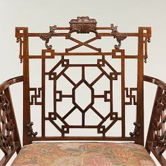 Intricate fretwork influenced by master cabinetmaker Thomas Chippendale an amazing armchair.