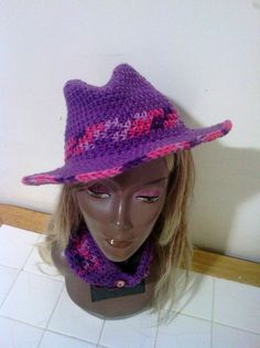 The Funky Crochet Fedora done in Purples and Pinks..iF  you would like to purchase this hat you can go to our Facebook page www.facebook.com/AlmbjHandmade or you can order directly for our Etsy page www.etsy.com/shop/ALMBandJHANDMADE